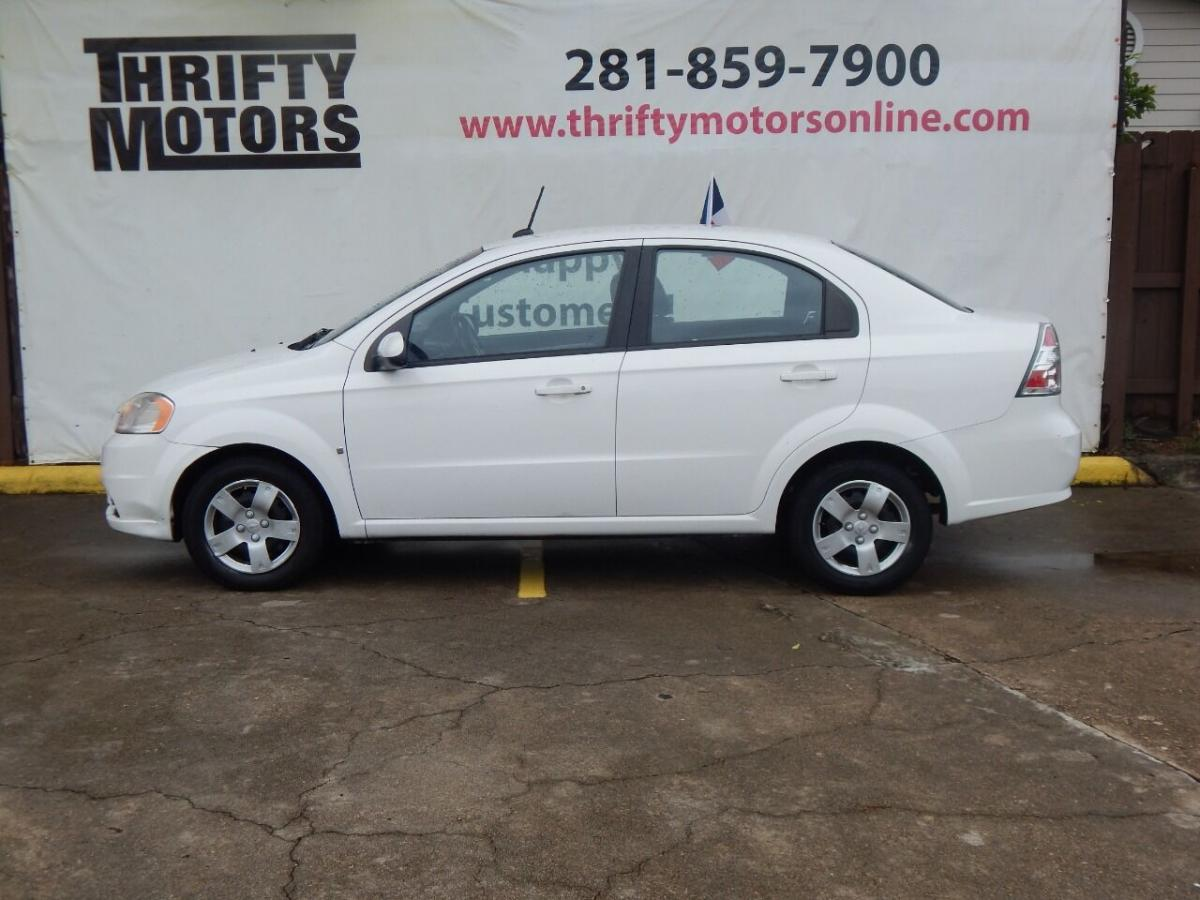 2009 White Chevrolet Aveo (KL1TD56E69B) with an 1.6L I4 1.6L I4 engine, Manual 5-Speed transmission, located at 4509 Highway 6 North, Houston, TX, 77084, (281) 859-4646, 29.848997, -95.645760 - Photo #0